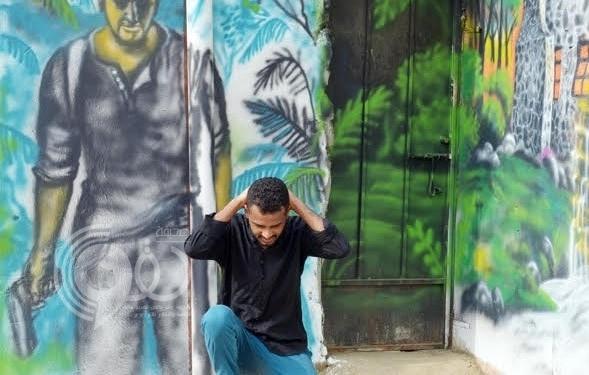 """بالصور.. شباب """"الشامية"""" يزينون وسط جازان استعداداً للاحتفال بالعيد"""