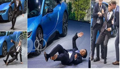 شاهد ..لحظة سقوط الرئيس التنفيذي لشركة بي إم دبليو في مؤتمر صحفي