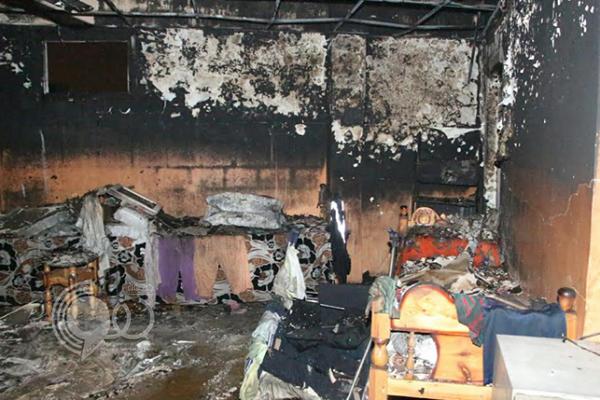"""بالصور : """"مدني جازان"""" يمنع انتشار النيران ببناية سكنية وينقذ شخصين"""