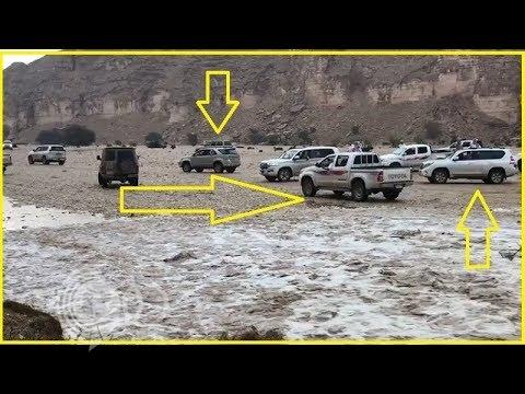 شاهد لحظة وصول سيل إلى سد الحلوة و وقوف مواطنون أمامه بسيارتهم